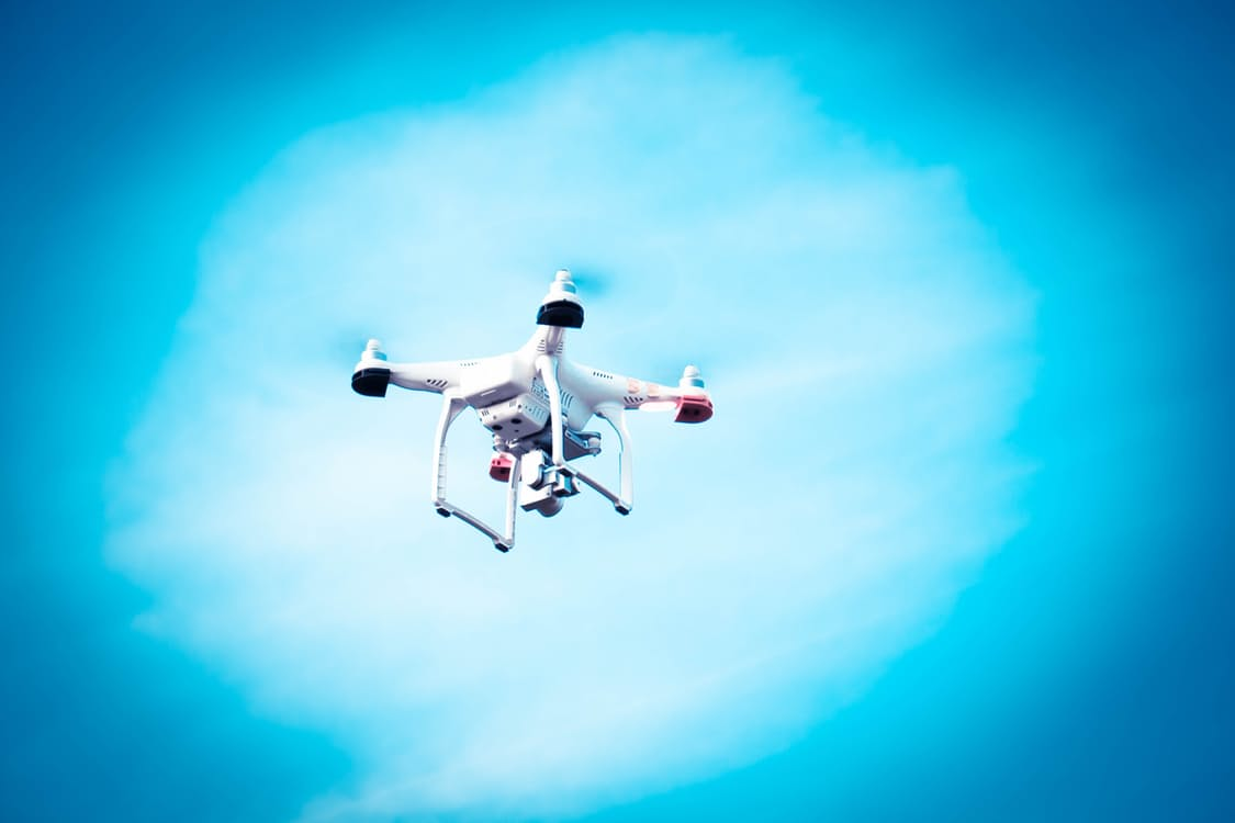 A drone flying in a blue sky