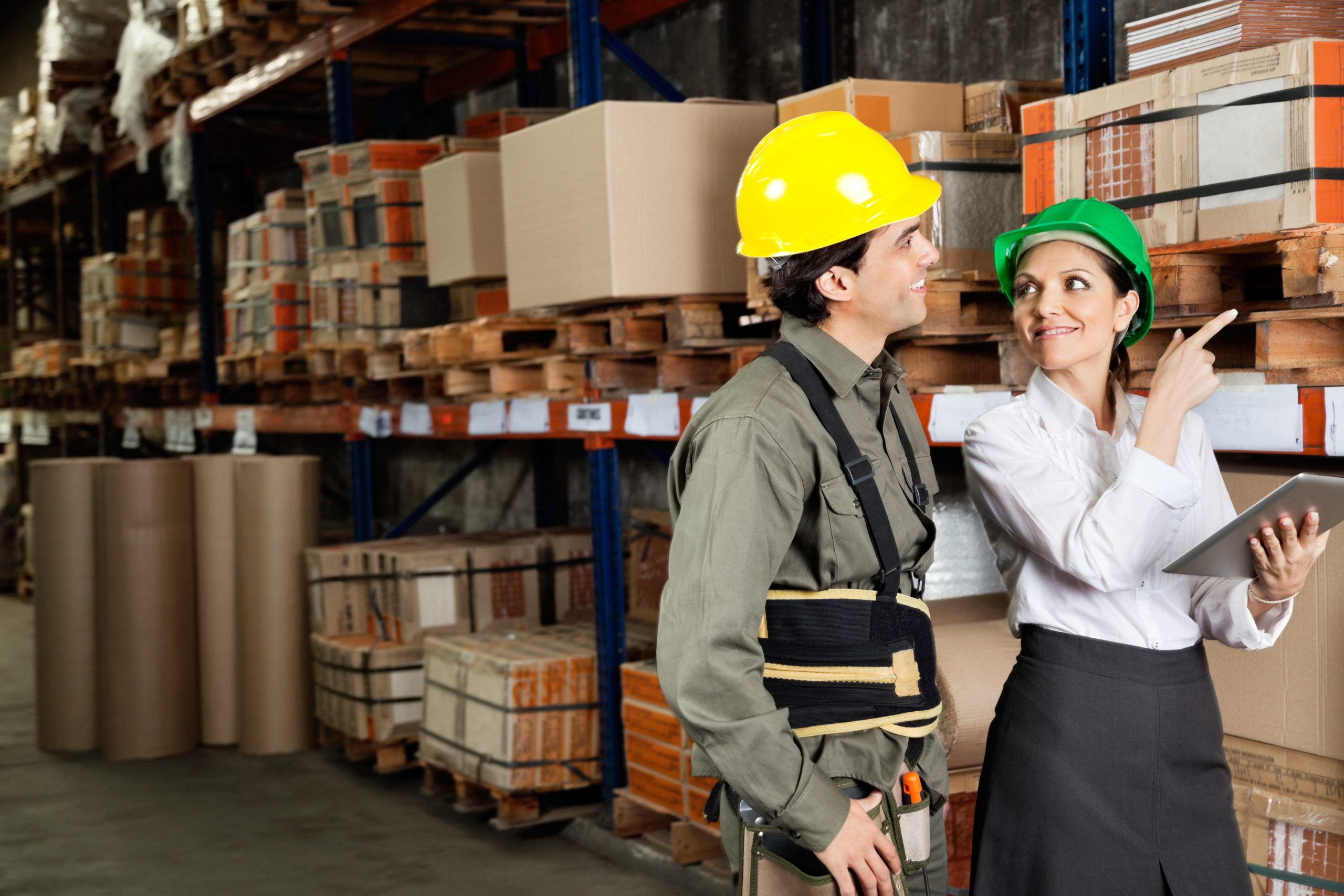 a man and a woman performing a racking inspection