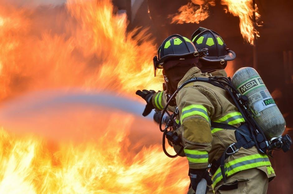 firemen fighting a warehouse fire