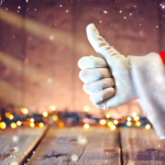 santa giving a thumbs up in a warehouse