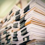 Stacks of papers detailing HSE's guidelines
