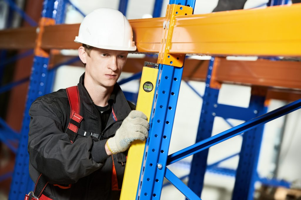 A racking inspection being carried out following SEMA racking inspection guidelines