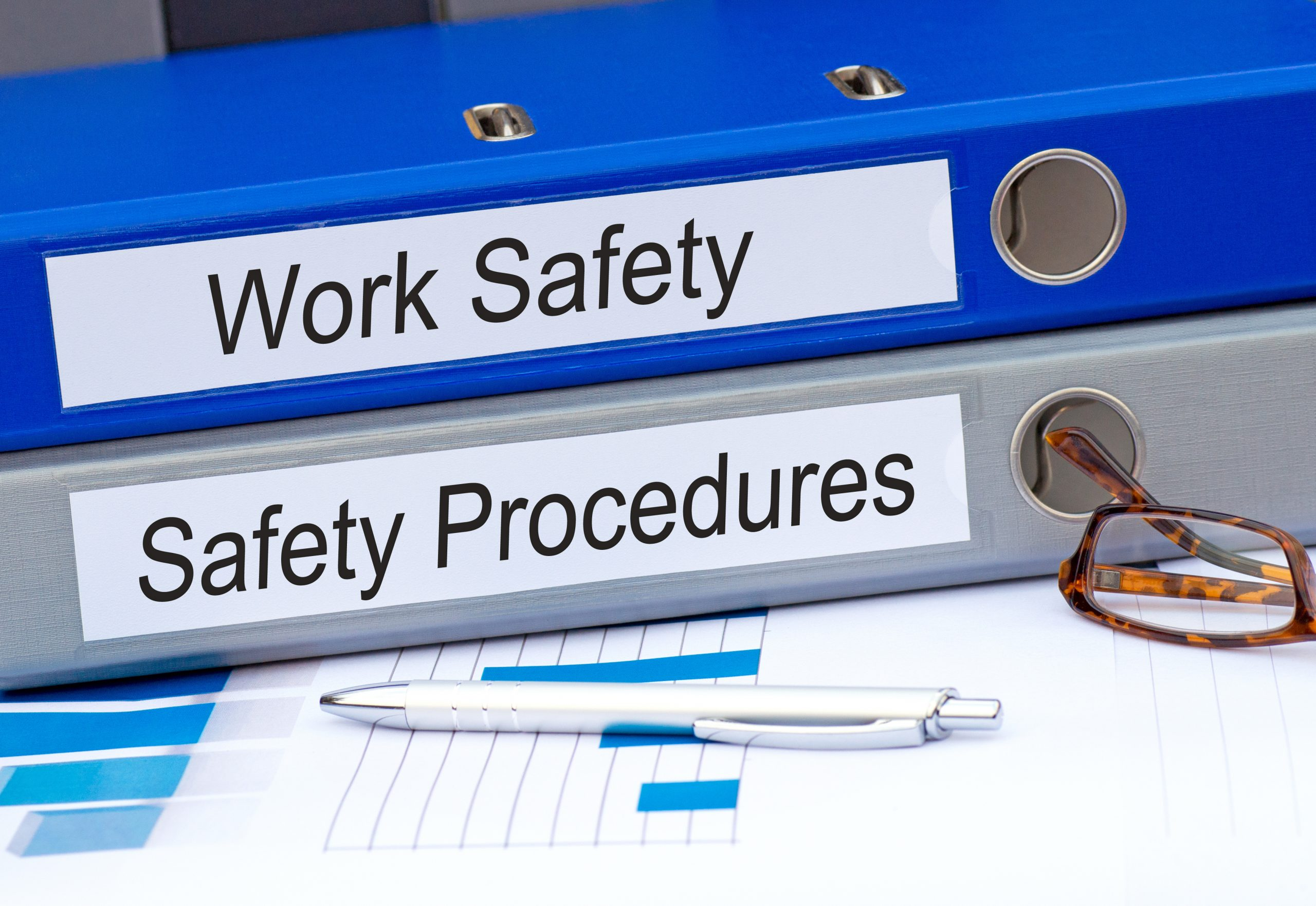 workplace safety and safety procedures folders on a desk