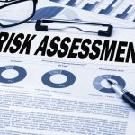 risk assessment analysis concept on clipboard